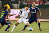 Benny Feilhaber tries to get past Nick LaBrocca and Simon Elliott during the game — Stock Photo