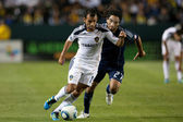 Juninho and Stephane Auvray in action during the Major League Soccer game — Stock Photo