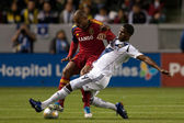 Edson Buddle tackles Jamison Olave during the game — Stock Photo