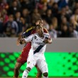 Edson Buddle and Chris Schuler in action during the Major League Soccer game — ストック写真