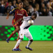 Edson Buddle and Chris Schuler in action during the Major League Soccer game - Stock Photo