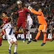 Jamison Olave  gets a head on a corner kick while Nick Rimando tries to punch it away during the  game - Stock Photo
