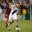 Sebastian Velasquez chases down Landon Donovan during the game — Stock Photo #16990187