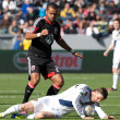 David Beckham goes down in front of Maicon Santos during the game - Stock Photo