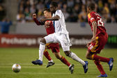 Edson Buddle and Sebastian Velasquez fight for the ball during the Major League Soccer game — Stock Photo