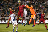 Jamison Olave gets a head on a corner kick while Nick Rimando tries to punch it away during the game — Stock Photo