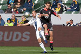 Landon Donovan and Chris Korb in action during the game — Stock Photo