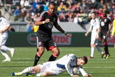 David Beckham goes down in front of Maicon Santos during the game — Stock Photo