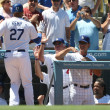 Stock Photo: MATT KEMP gets conratulated by coaches and teammates after hitting home run during game