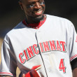 BRANDON PHILLIPS has a laugh with the 3rd base coach during the game — Stock Photo
