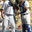 Stock Photo: JONATHAN BROXTON and A.J. ELLIS have quick chat during game