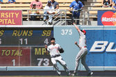 DREW STUBBS catches a deep flyball while JONNY GOMES looks on during the game — Stok fotoğraf