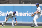 MATT KEMP scoops up a grounder that made it out of the infield during the game — Stock Photo