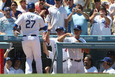 MATT KEMP gets conratulated by coaches and teammates after hitting a home run during the game — Stock Photo