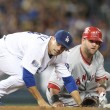 ストック写真: Jamey Carroll and Mike Napoli look to see if a double play was completed during the game