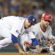 Foto Stock: Jamey Carroll and Mike Napoli look to see if a double play was completed during the game