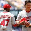 Howard Kendrick brings Hideki Matsui his glove and hat during the game — Stock Photo