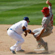 Постер, плакат: Robb Quinlan tries to beat the tag by Rafael Furcal during the game