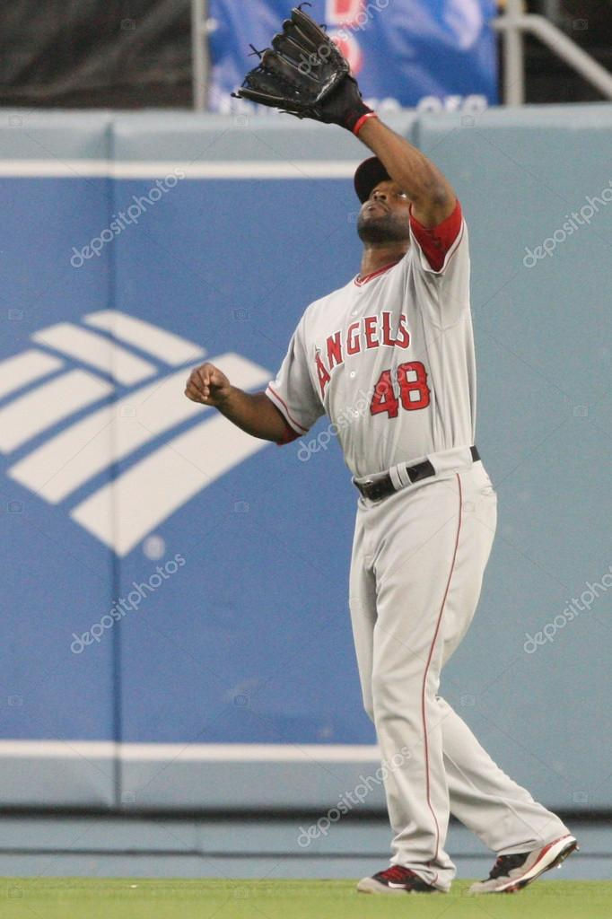 12 June 2010: Angels CF Torii Hunter catches a fly ball during the Angels vs. Dodgers match at Dodgers Stadium in Los Angeles, California. The Angels went on to defeat the Dodgers with a final score of 4-2 — Stock Photo #18519577