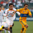 Oscar Razo and Lucas Lobos in action during the InterLiga 2010 match - Stock Photo