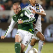Kris Boyd and Sean Franklin in action during the Major League Soccer game — Stock Photo