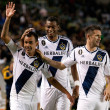 Juninho celebrates his goal with teammates during the Major League Soccer game - Stock Photo