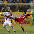 Robbie Keane  and  George John during the Major League Soccer game — Stock fotografie