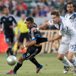 Bryan Gaul and  Sercan Guvenisik in action during the Major League Soccer game - Stock Photo