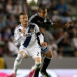 David Beckham and San Jose Earthquakes defender Justin Morrow in action during the Major League Soccer game — Stock Photo