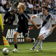 Bryan Gaul  and Steven Lenhart in action during the Major League Soccer game - Stock Photo