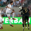 Постер, плакат: Kaka and Sean Franklin in action during the World Football Challenge game
