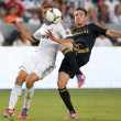 Bryan Gaul and  Nacho Fernandez in action during the World Football Challenge game - Stock Photo