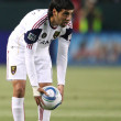 Постер, плакат: Javier Morales sets the ball up for a free kick during the game