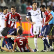 Marcelo Saragosa gets checked out by medical staff during the game — ストック写真