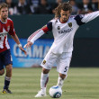 Kyle Beckerman controls and passes the ball while being pressured by Blair Gavin  during the game - Stock Photo
