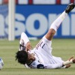 Stock Photo: Javier Morales trips and falls mid dribble during game