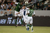 Hanyer Mosquera and Robbie Keane fight for a header during the Major League Soccer game — Stock Photo