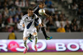 David Beckham and San Jose Earthquakes defender Justin Morrow in action during the Major League Soccer game — Stok fotoğraf