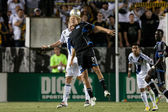Teven Lenhart and Bryan Gaul fight for a header during the Major League Soccer game — Stock Photo