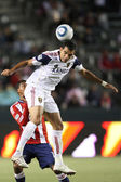 Pablo Campos goes up for a header against Dario Delgado during the game — Stock Photo
