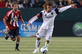 Kyle Beckerman controls and passes the ball while being pressured by Blair Gavin during the game — Stock Photo