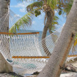 Lazy hammock on beach — Stock Photo