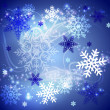 Blue snowflakes background. — Stock Vector