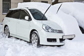 White car is under the snow — Stock Photo