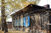 The wooden house with window shutters on Irkutsk street — Stock Photo