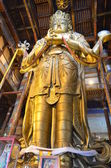 The highest 25 meters gold Buddha figure in the central temple of Gandanteqchilin monastery Ulan-Bator — Stock Photo