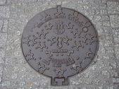 Krakow. Manhole on the pedestrian street — Stock Photo