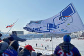 Team fans with flag on spectator grandstands — Стоковое фото