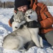 Man with two dogs of breed husky in the winter on the snow — Stock Photo