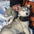 Stock Photo: Man with two dogs of breed husky in the winter on the snow